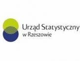 Logo - napis Urząd Statystyczny w Rzeszowie, po lewej stronie ułożone w pionie dwa koła: na górze zielone pod spodem niebieskie.
